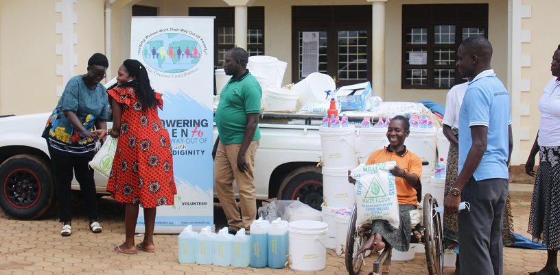People delivering pandemic supplies to Uganda.