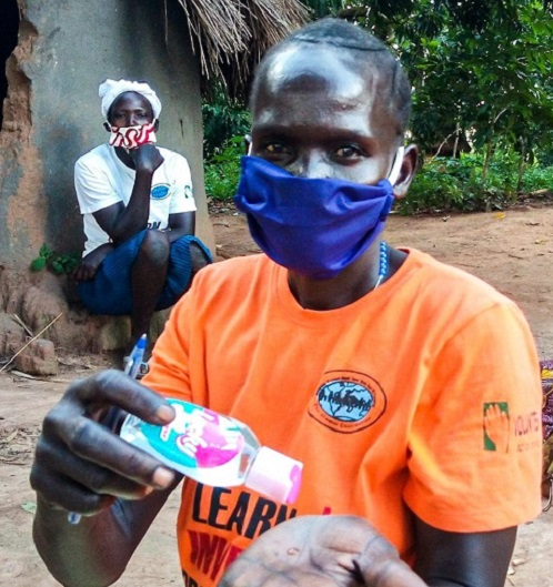 Woman applying hand sanitizer.